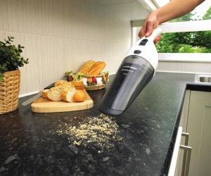 black and decker dustbuster picking up bread crumbs